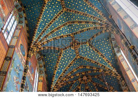 POLAND, KRAKOW - MAY 27, 2016: Ceiling interior of a medieval gothic St Mary's church in Krakow. St. Mary's Church was built in the XIII-XIV century.