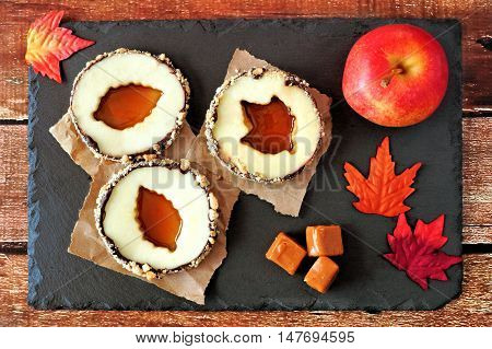 Autumn Apple Rounds With Caramel Filled Centers, Downward View On Slate Server