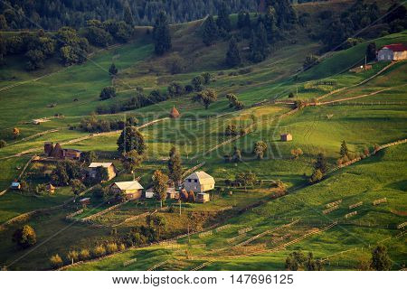 September Rural Scene In Mountains. Authentic Village And Fence