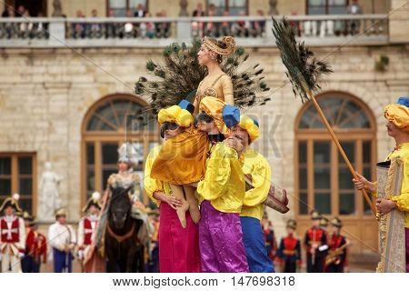 GATCHINA, ST. PETERSBURG, RUSSIA - SEPTEMBER 10, 2016: Actors in Eastern costumes in the show during the festival Gatchinskaya Byl. The festival is held first time this year