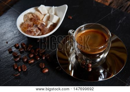 Top view of a cup of coffee on black stone