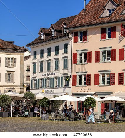 Rapperswil, Switzerland - September 12, 2016: historic buildings on Fischmarktplatz square. Rapperswil is a part of the municipality of Rapperswil-Jona in the Swiss canton of St. Gallen, located on the east side of Lake Zurich.