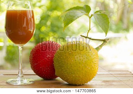Green baby Jackfruit and juice on wooden background.fruit for health and stillife.001