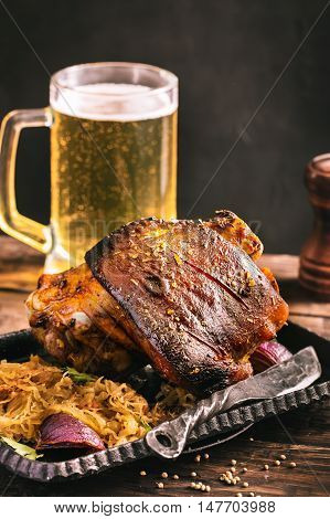 Rustic eisbein with braised cabbage and beer.Toned