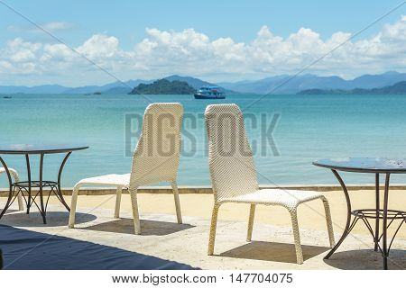 restaurant table at seaside resort with blue sky