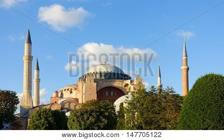 The last golden rays of sun are illuminating the Hagia Sophia in Istanbul Turkey during Golden Hour.