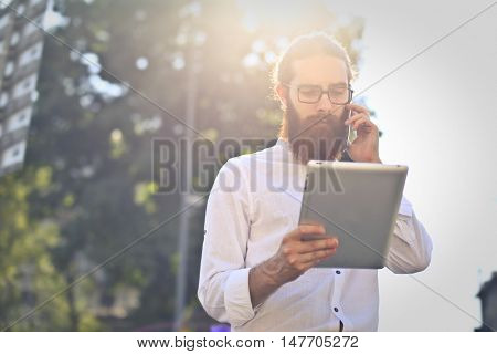 Businessman using technological devices