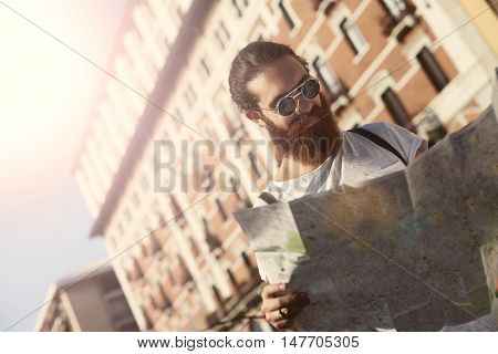Man on a journey using a map