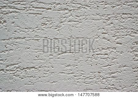 A closeup of a white/beige wall for texture/background
