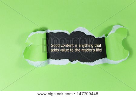 The quote Good content is anything that adds value to the readers life, appearing behind torn paper.