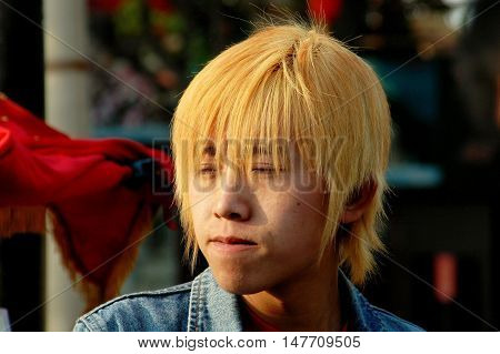 Beijing China - May 5 2005: Trendy Chinese youth with bleached blond hair at the Shi Sa Hai Hutong