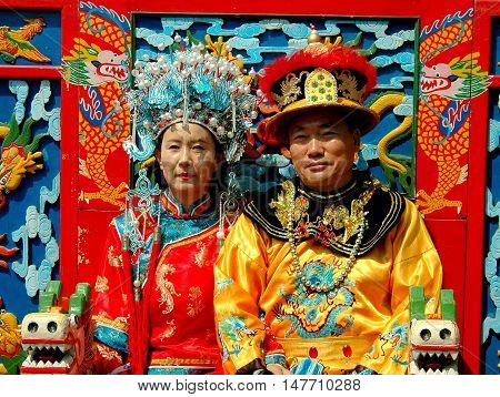 Beijing China - May 5 2005: Husband and wife pose in rented traditional Chinese ceremonial robes in Jing Shan Park