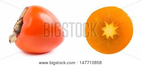 The cut and whole persimmon isolated on white background