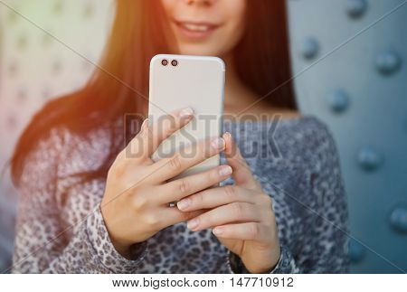 Girl Taking Photo With Modern Dual Camera Smart Phone