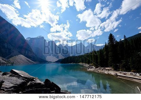 Sunshine over picturesque lake Moraine in Banff National Park.  Rocky Mountains. Alberta. Canada.
