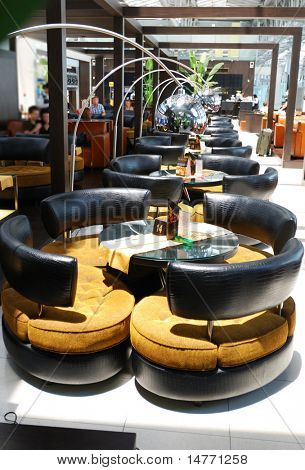 Lounge modern interior.  No recognizable faces or brandnames.