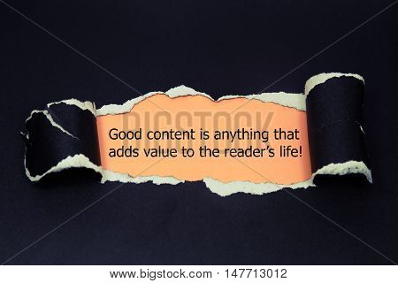 The quote Good content is anything that adds value to the readers life, appearing behind torn brown paper.