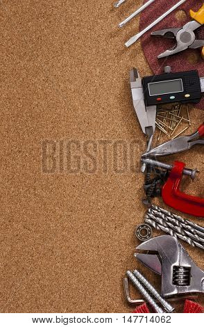 Various tools from right border of brown background