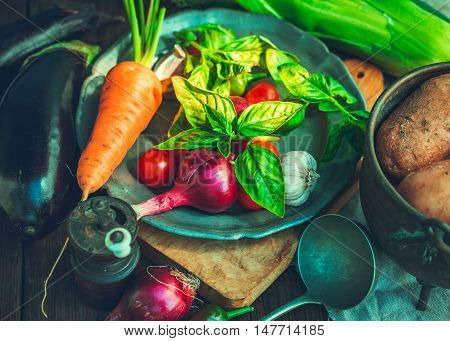 Various vegetables on rustic table closeup shot