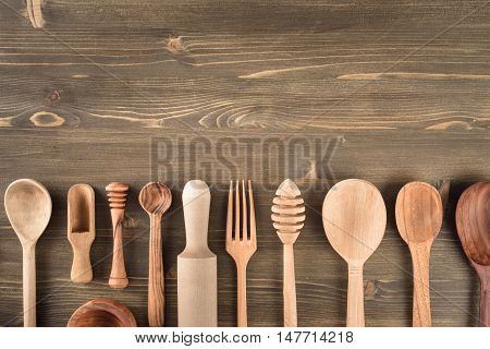 Various wooden kitchen utensils on table top view with copy space