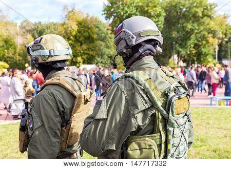 SAMARA RUSSIA - SEPTEMBER 11 2016: Unidentified members of military club in camouflage army uniform and helmet (full gear) during military reenacting in Samara Russia