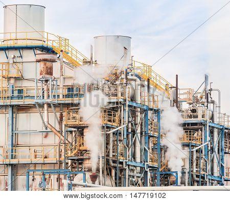 Smokestacks pipes  smoke and tank of chemical plant