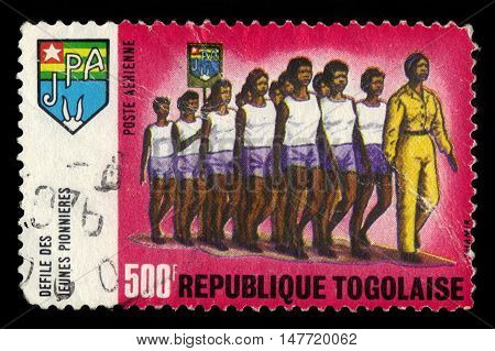 TOGO - CIRCA 1969: A stamp printed in Togo shows the parade of young pioneers, series youth working pionners, circa 1969