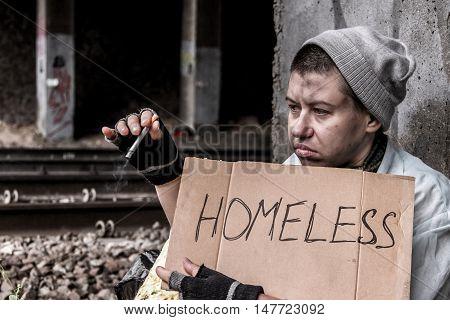 Homeless Woman Smoking