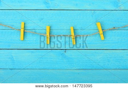 Four clips on wooden wall