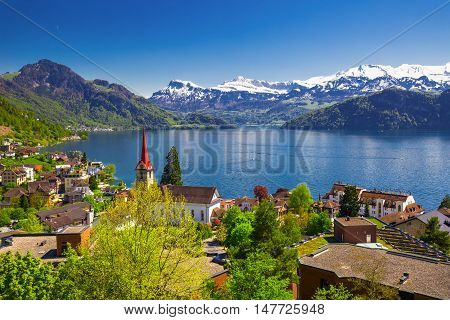 Panorama image of village Weggis lake Lucerne (Vierwaldstatersee) Pilatus mountain and Swiss Alps in the background near famous Lucerne (Luzern) city Switzerland