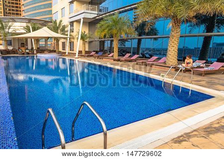 DUBAI, UAE - 31 MARCH 2014: Pool area of The Grand Midwest Tower Hotel in Dubai, UAE. The Grand Midwest Group owns 4 hotels in Dubai with over 700 rooms.