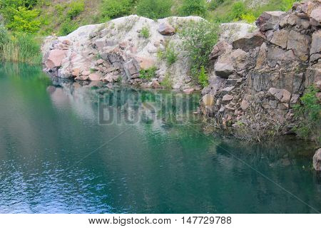 Beautiful lake at abandoned quarry on summer