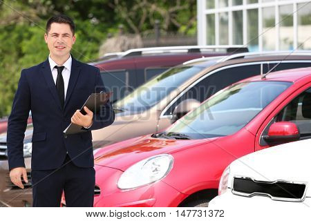 Car dealer on new cars background