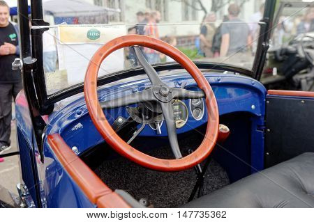 Kharkiv Ukraine - May 22 2016: Inside view of Chevrolet retro car manufactured in 1921 exhibited at the festival of vintage cars Kharkiv Retro Rally - 2016 in Kharkiv Ukraine on May 22 2016