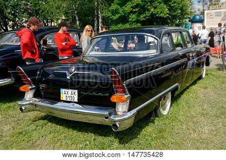 Kharkiv Ukraine - May 22 2016: Soviet retro car black GAZ-13 Chayka manufactured between 1959 and 1981 is presented at the festival of vintage cars Kharkiv Retro Rally - 2016 in Kharkiv Ukraine on May 22 2016