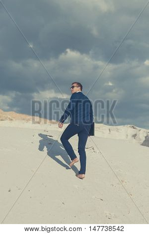 Businessman On Desert