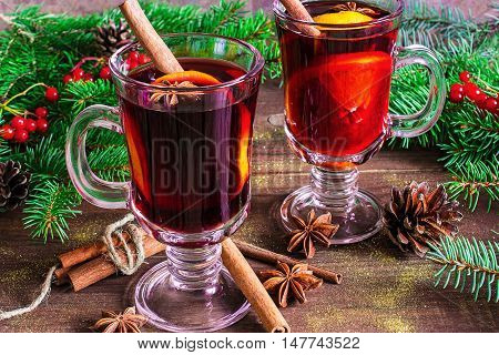 christmas mulled wine with spices pine cones and . hot alcohol drinks