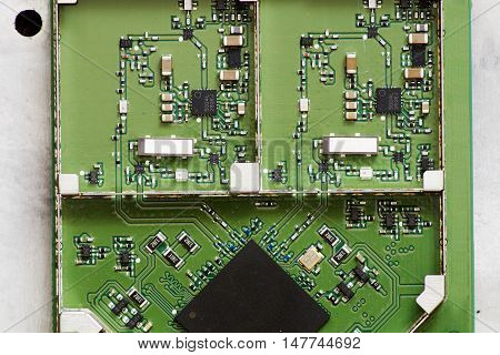 Miniature electronic board with radio components and processor
