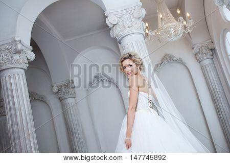 Charming young bride in luxurious wedding dress. Pretty girl, photo Studio