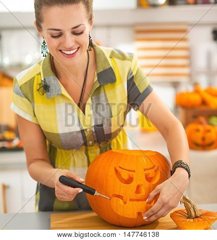 Happy Housewife Carving A Big Orange Pumpkin Jack-o-lantern