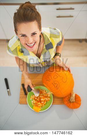Happy Woman Carving A Big Orange Pumpkin Jack-o-lantern