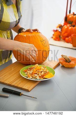 Closeup On Housewife Prepare Big Pumpkin For Halloween Party