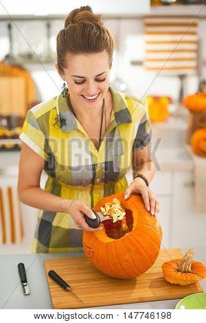Happy Woman Prepare Big Orange Pumpkin For Halloween Party