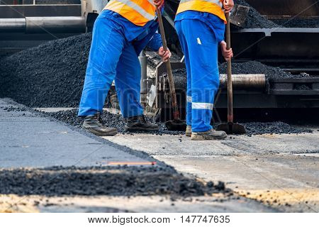 The Workers And The Asphalting Machines