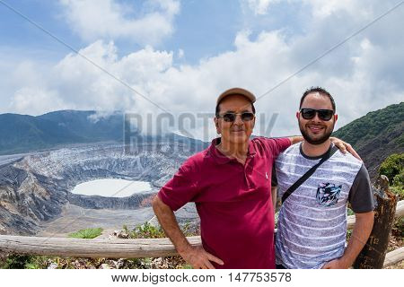 Father And Son Portrait With A Volcano In The Background