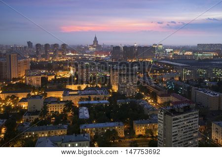 Residential buildings in sleeping area, skyscrapers and roofs at summer night in Moscow, Russia, Khoroshyovsky District