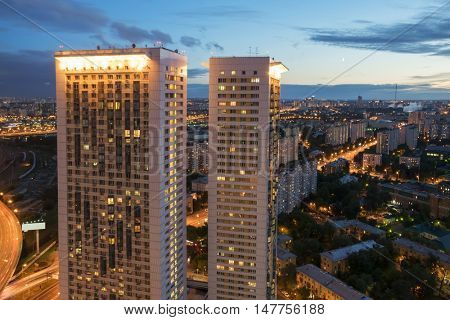 MOSCOW, RUSSIA - JUL 8, 2016: Buildings on Begovaya street at night, twin 38-storey towers - is part of largest residential complex with 1946 apartments in Moscow