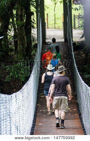 Tourists On A Hanging Bridge