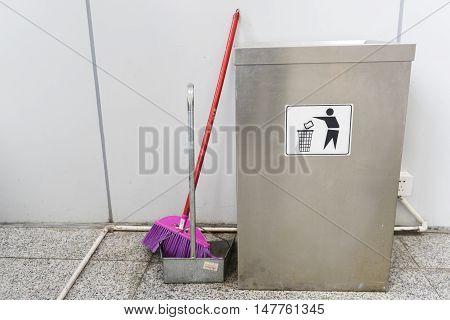 Public rubbish bin on the wet floor