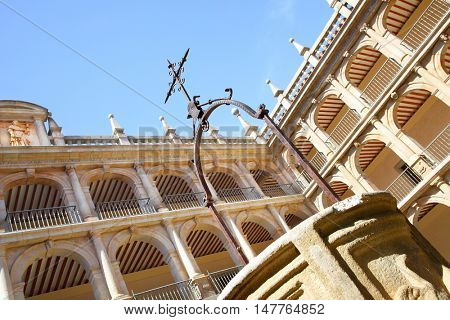 Courtyard of The University of Alcala (originally founded in 1293), Alcala de Henares, Spain. Focus on the cross!
